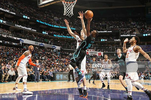 Kemba Walker of the Charlotte Hornets shoots the ball against the New York Knicks during the game on November 26 2016 at Spectrum Center in Charlotte...