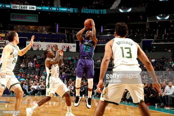 Kemba Walker of the Charlotte Hornets shoots the ball against the Milwaukee Bucks on November 26 2018 at Spectrum Center in Charlotte North Carolina...