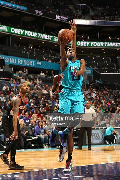 Kemba Walker of the Charlotte Hornets shoots the ball against the Portland Trail Blazers on November 15 2015 at Time Warner Cable Arena in Charlotte...