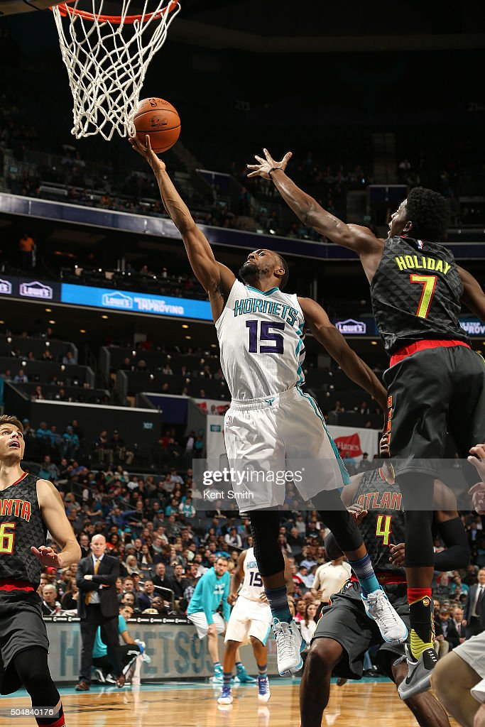 Kemba Walker #15 of the Charlotte Hornets shoots the ball against the Atlanta Hawks on January 13, 2016 at Time Warner Cable Arena in Charlotte, North Carolina.