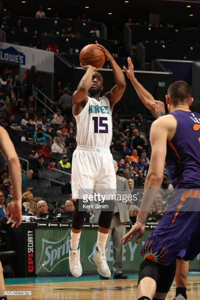 Kemba Walker of the Charlotte Hornets shoots the ball against the Phoenix Suns on March 26 2017 at Spectrum Center in Charlotte North Carolina NOTE...