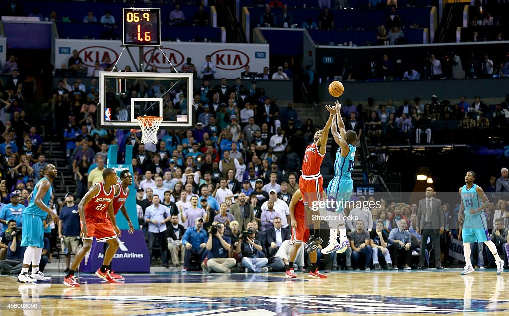 Kemba Walker #15 of the Charlotte Hornets shoots the game winning shot over Brandon Knight #11 of the Milwaukee Bucks during their game at Time Warner Cable Arena on October 29, 2014 in Charlotte, North Carolina. The Charlotte Hornets defeated the Milwaukee Bucks 108-106.