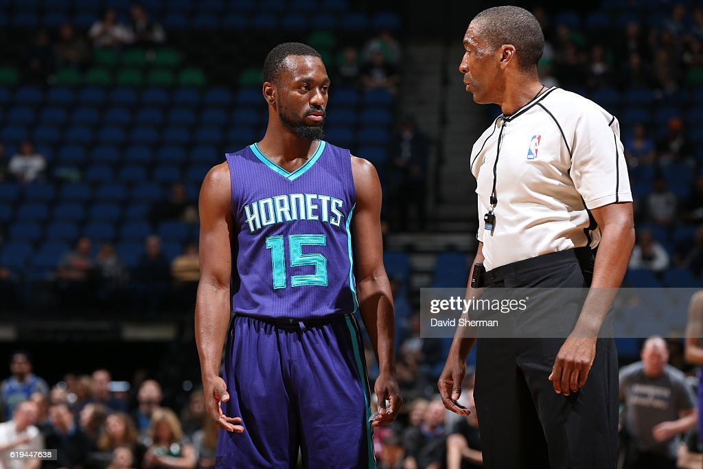 Kemba Walker #15 of the Charlotte Hornets talks to Referee, Leon Wood during an NBA preseason game against the Minnesota Timberwolves on October 21, 2016 at the Target Center in Minneapolis, Minnesota.