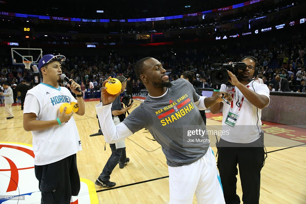 Kemba Walker of the Charlotte Hornets tosses balls to the fans after the game against the Los Angeles Clippers as part of the 2015 NBA Global Games China at the Mercedes-Benz Arena on October 14, 2015 in Shanghai, China.