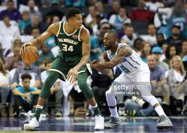Kemba Walker of the Charlotte Hornets tries to stop Giannis Antetokounmpo of the Milwaukee Bucks during their game at Spectrum Center on October 17...