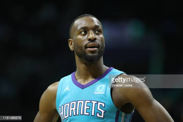 Kemba Walker of the Charlotte Hornets watches on against the Washington Wizards during their game at Spectrum Center on February 22 2019 in Charlotte...