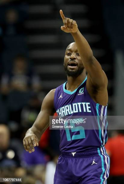 Kemba Walker of the Charlotte Hornets watches on before their game against the New Orleans Pelicans at Spectrum Center on December 2 2018 in...