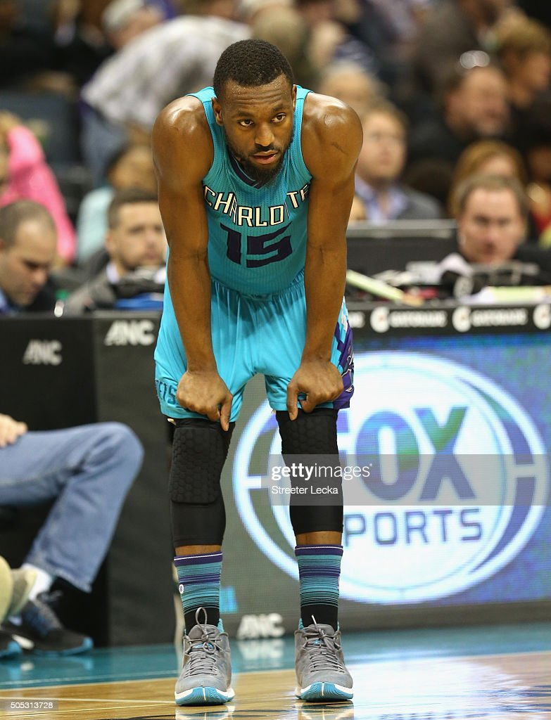 Kemba Walker #15 of the Charlotte Hornets watches on during their game against the Milwaukee Bucks at Time Warner Cable Arena on January 16, 2016 in Charlotte, North Carolina.