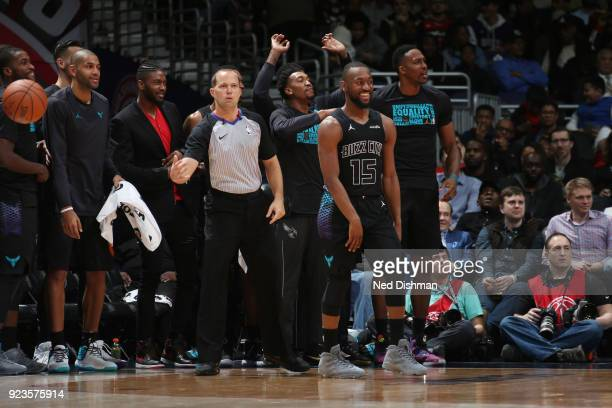 Kemba Walker of the Charlotte Hornets with his teammates react to a play against the Washington Wizards on February 23 2018 at Capital One Arena in...