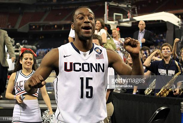 Kemba Walker of the Connecticut Huskies celebrates after defeating the Kentucky Wildcats during the National Semifinal game of the 2011 NCAA Division...