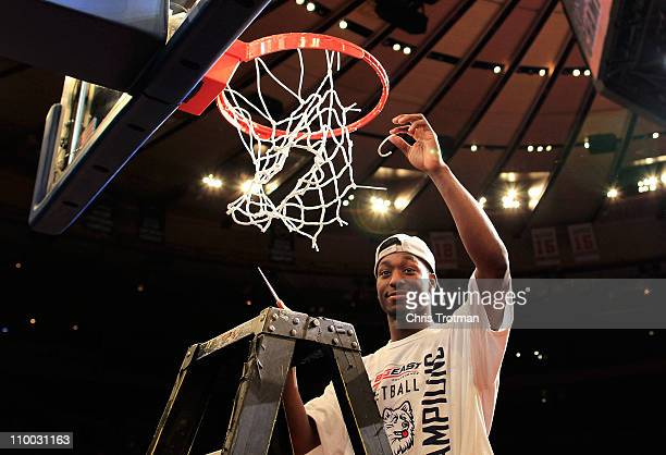 Kemba Walker of the Connecticut Huskies cuts down the net after defeating the Louisville Cardinals during the championship of the 2011 Big East Men's...