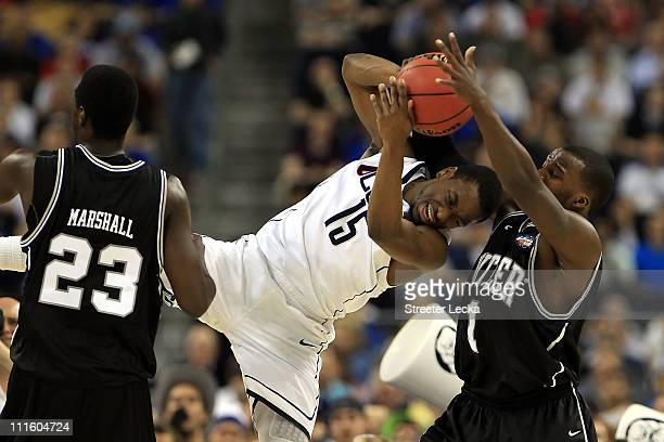 Kemba Walker of the Connecticut Huskies fights for the ball against Shelvin Mack of the Butler Bulldogs during the National Championship Game of the...