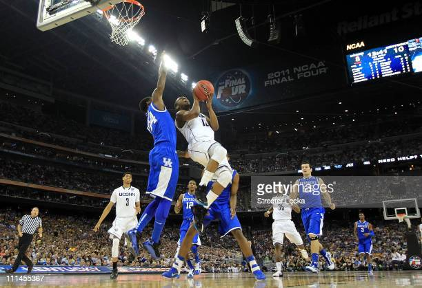 Kemba Walker of the Connecticut Huskies goes up for a shoot against DeAndre Liggins of the Kentucky Wildcats during the National Semifinal game of...