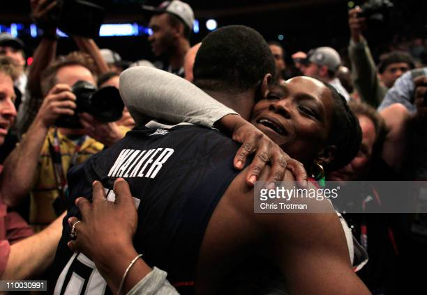 Kemba Walker of the Connecticut Huskies hugs his mother after defeating the Louisville Cardinals during the championship of the 2011 Big East Men's...
