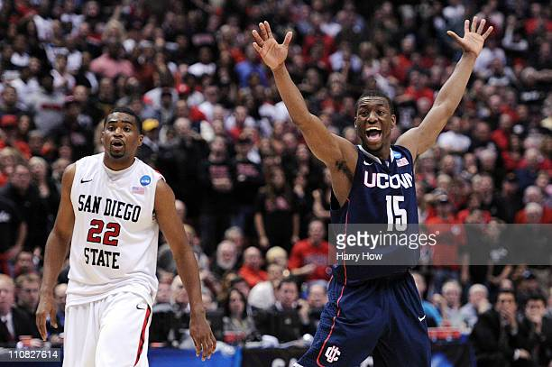 Kemba Walker of the Connecticut Huskies reacts after a play against Chase Tapley of the San Diego State Aztecs looks on during the west regional...