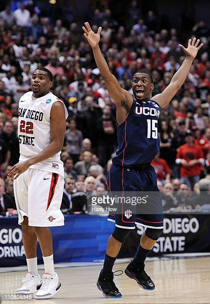 Kemba Walker of the Connecticut Huskies reacts after making a play late in the game as Chase Tapley of the San Diego State Aztecs looks on during the...
