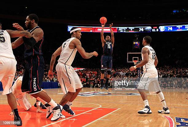 Kemba Walker of the Connecticut Huskies shoots a game winning basket against the Pittsburgh Panthers during the quarterfinals of the 2011 Big East...