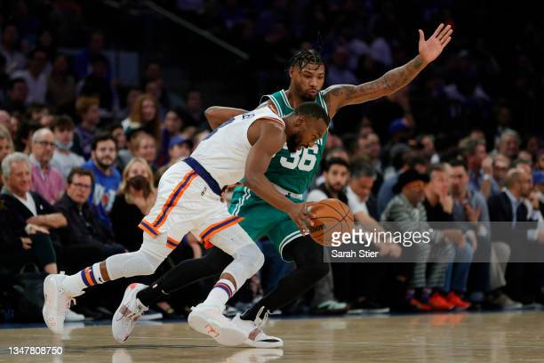 Kemba Walker of the New York Knicks dribbles against Marcus Smart of the Boston Celtics during the second half at Madison Square Garden on October...