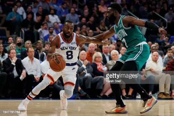 Kemba Walker of the New York Knicks dribbles as Jaylen Brown of the Boston Celtics defends during the first half at Madison Square Garden on October...