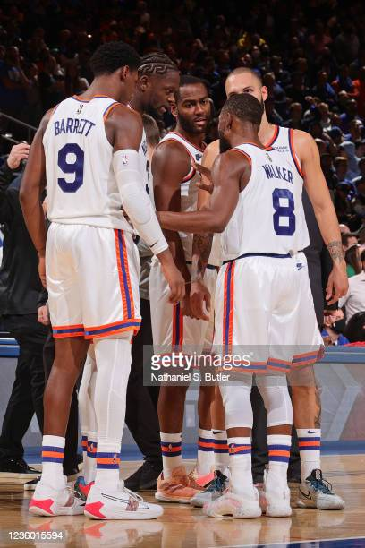 Kemba Walker of the New York Knicks huddles up with his team against the Boston Celtics on October 20, 2021 at Madison Square Garden in New York, New...