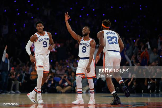 Kemba Walker of the New York Knicks reacts with RJ Barrett and Mitchell Robinson of the New York Knicks during the first half against the Boston...