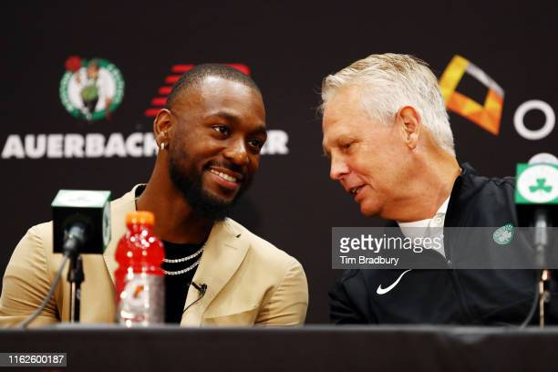 Kemba Walker talks with Celtics President of Basketball Operations Danny Ainge during a press conference as he is introduced as a member of the...