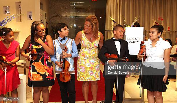 Kemberly Richardson with Harlem's Opus 118 attends the Color of Broadway presented by Saks Fifth Avenue at Saks Fifth Avenue on June 9 2011 in New...