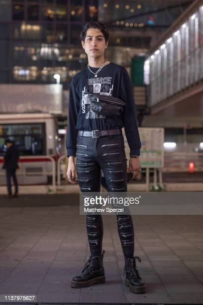 Kemio is seen wearing black graphic shirt black pants with multiple zippers crossbody bag during the Amazon Fashion Week TOKYO 2019 A/W on March 23...