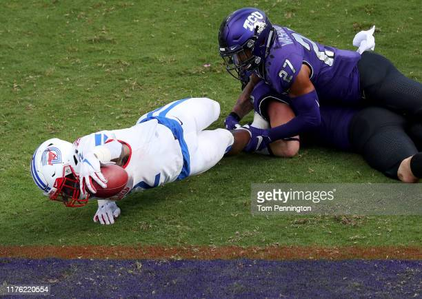 Ke'Mon Freeman of the Southern Methodist Mustangs scores a touchdown against Ar'Darius Washington of the TCU Horned Frogs in the second quarter at...