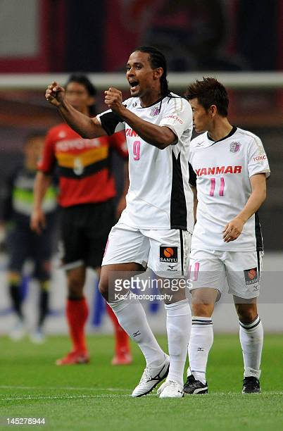 Kempes, whose real name is Everton Kempes dos Santos Goncalves of Cerezo Osaka celebrates scoring the first goal during the J.League match between...