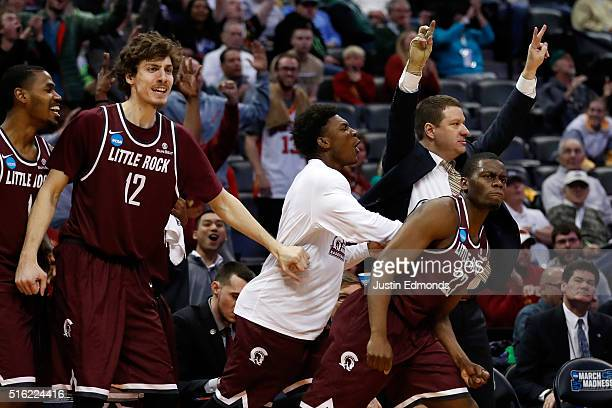 Kemy Osse of the Arkansas Little Rock Trojans reacts after making a three point shot over Ryan Cline of the Purdue Boilermakers in overtime during...