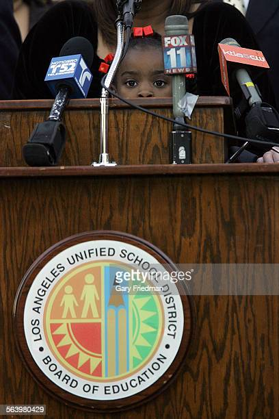 Kemyia Bullard is a 1st grade at Florence Griffin Joyner Elementary School She peers over a bank of microphone where her grandmother was speaking...