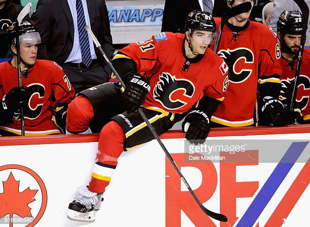 Ken Agostino of the Calgary Flames plays against the Vancouver Canucks during the preseason game at Scotiabank Saddledome on September 25 2014 in...