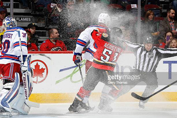Ken Agostino of the Calgary Flames skates against Dan Girardi and Henrik Lundqvist of the New York Rangers at Scotiabank Saddledome on March 28 2014...