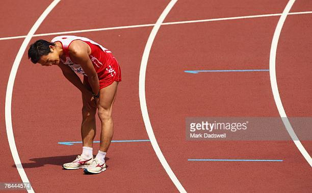 Ken Akashi of Japan stops exhausted after crossing the finish line in the Men's 50k Race Walk on day eight of the 11th IAAF World Athletics...
