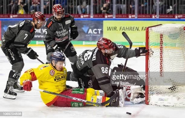 Ken Andre Olimb of Duesseldorf challenges Benjamin Hanowski of Koeln during the DEL match between Koelner Haie and Duesseldorfer EG at Lanxess Arena...