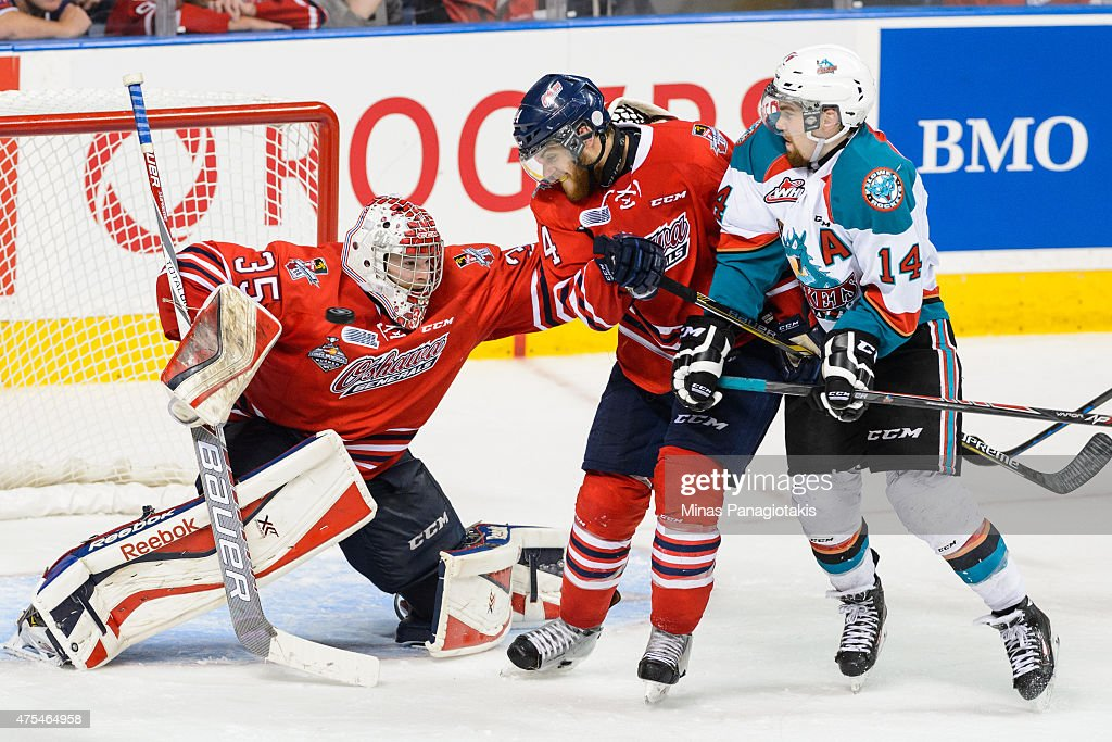 Ken Appleby #35 of the Oshawa Generals makes a save as teammate Dakota Mermis #44 defends against Rourke Chartier #14 of the Kelowna Rockets during the 2015 Memorial Cup Championship at the Pepsi Coliseum on May 31, 2015 in Quebec City, Quebec, Canada.