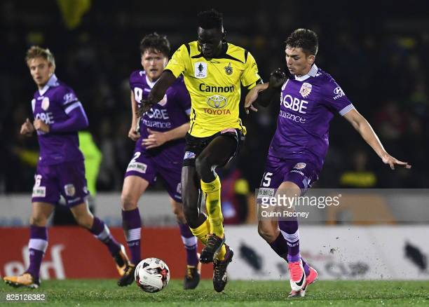 Ken Athiu of United controls the ball past Brandon Wilson of Glory during the FFA Cup round of 32 match between Heidelberg United FC and Perth Glory...