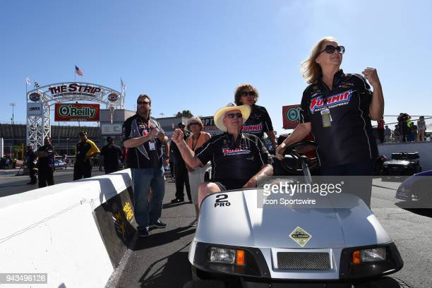 Ken Black and wife Judy cheer on Brittany Force John Force Racing NHRA Top Fuel Dragster as he makes his semifinal run during the DENSO Spark Plugs...