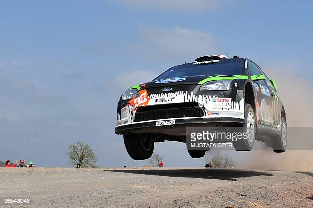 US Ken Block and Alex Gelsomino compete in their Monster World Rally Team Ford Focus during the first leg of the WRC Rally of Turkey on April 17...