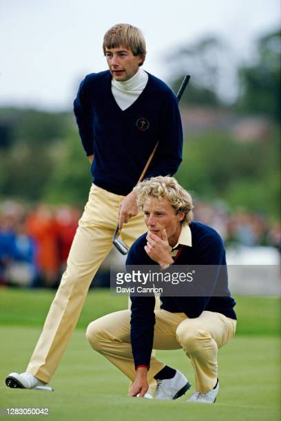 Ken Brown and Bernhard Langer of The European Team line up a putt on the 14th hole in their match against Ray Floyd and Lanny Wadkins of The United...