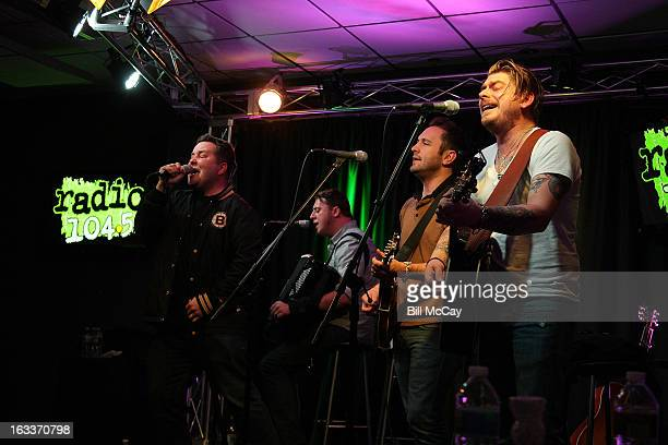 Ken Casey James Lynch Tim Brennan and Jeff DaRosa of Dropkick Murphys perform at Radio Station Q102 iHeartRadio Performance Theater March 8 2013 in...