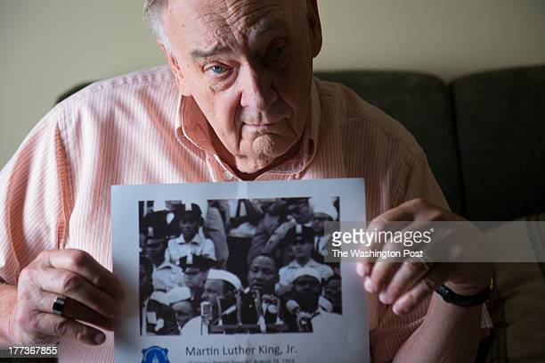 Ken Collins a former DC police officer poses for a portrait holding a photo of Martin Luther King giving his famous 'I have a dream speech' at his...