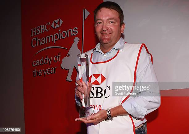 Ken Comboy who caddied for Graeme McDowell in 2010 poses with the caddy of the year award after the second round of the HSBC Champions at the Sheshan...