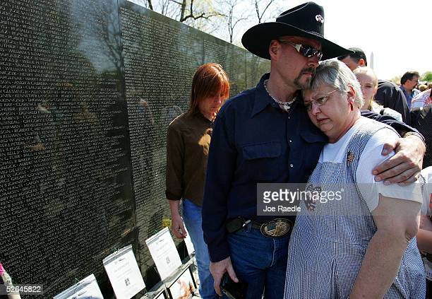 Ken Costner hugs Kay Lawrence from Indianapolis Indiana as they pay tribute to her husband James Richard Lawrence who served in the military during...