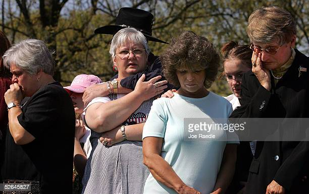 Ken Costner hugs Kay Lawrence from Indianapolis Indiana as they pay tribute along with others to relatives who served in the military during the...