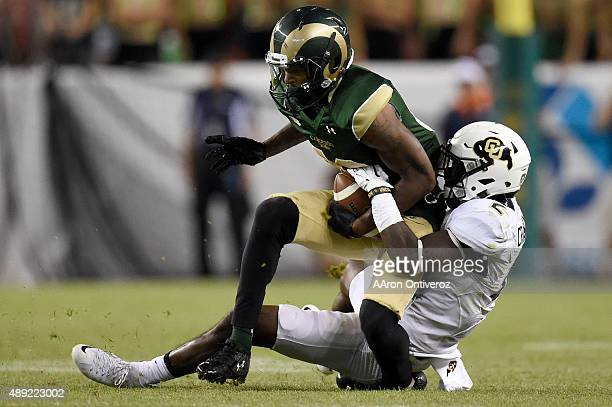 Ken Crawley of the Colorado Buffaloes stops Rashard Higgins of the Colorado State Rams during the second half of the Buffs' 2724 overtime Rocky...