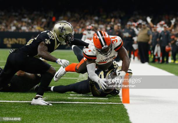 Ken Crawley of the New Orleans Saints and Demario Davis of the New Orleans Saints defend as Carlos Hyde of the Cleveland Browns scores a touchdown...