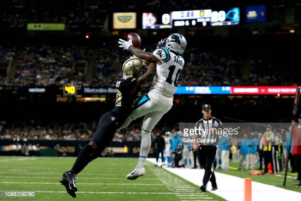 Ken Crawley of the New Orleans Saints breaks up a pass intended for Curtis Samuel of the Carolina Panthers during the first half during a NFL game at...