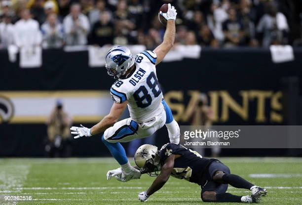 Ken Crawley of the New Orleans Saints tackles Greg Olsen of the Carolina Panthers during the second half of the NFC Wild Card playoff game at the...